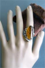 Amber ring on manikin