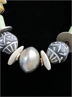 with Incised Whorl Beads