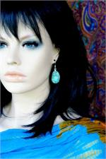 Turquoise earrings on manikin