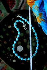 Turquoise necklace with ruler