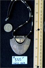 Shown with ruler and coin